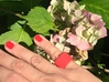 "Ingranaggi Band Ring (Fascia) 3d printed Red Strong & Flexible Plastic with a pale pinl ""ortensie"" background"