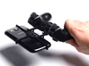 PS3 controller & BQ Aquaris M5 3d printed In hand - A Samsung Galaxy S3 and a black PS3 controller