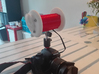 Binaural Mic Mount 3d printed the final product. The red center is the mic mount.