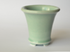 Round Bonsai-Style Shot Glass 3d printed Shown in Celedon Green glaze. This color appears to vary between a light blue and a light olive depending on the lighting.