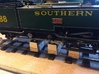 14mm Gauge Spacers for DCC Concepts Rolling Road 3d printed In use to test run an O14 locomotive